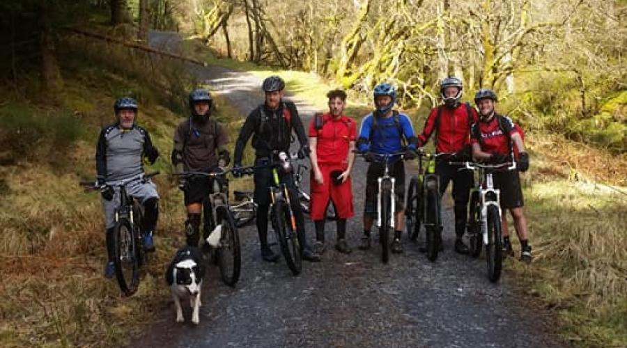 group of mountain bikers in forest