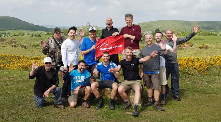 OutdoorLads group with Corfe Castle in the background