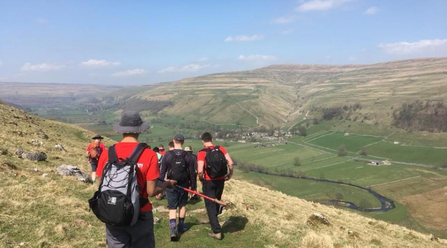 Great Whernside, walkers with backpacks.