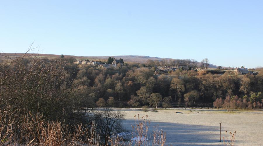 Lambley village from a distance on a frosty day