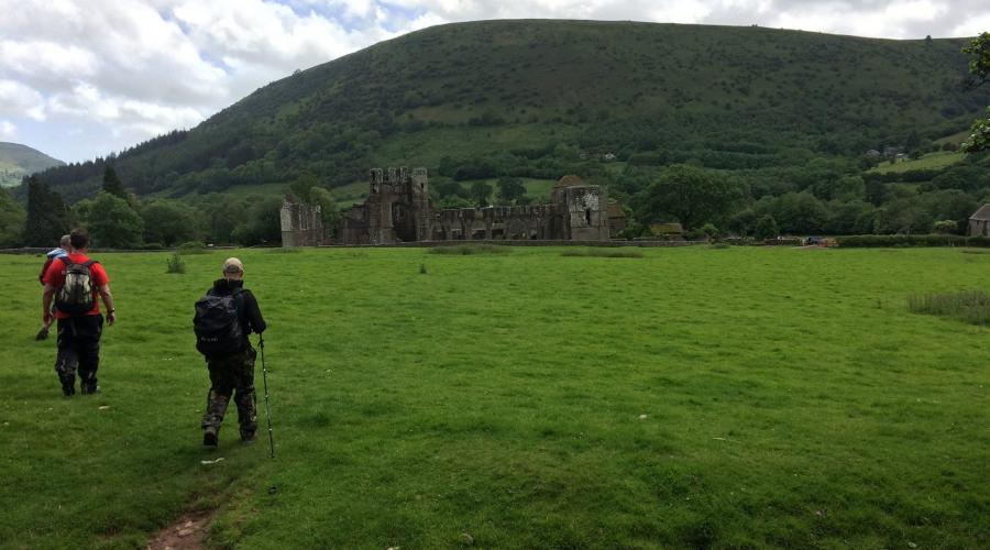 Walkers heading back to Llanthony Priory
