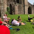 Walkers relaxing at Llanthony Priory