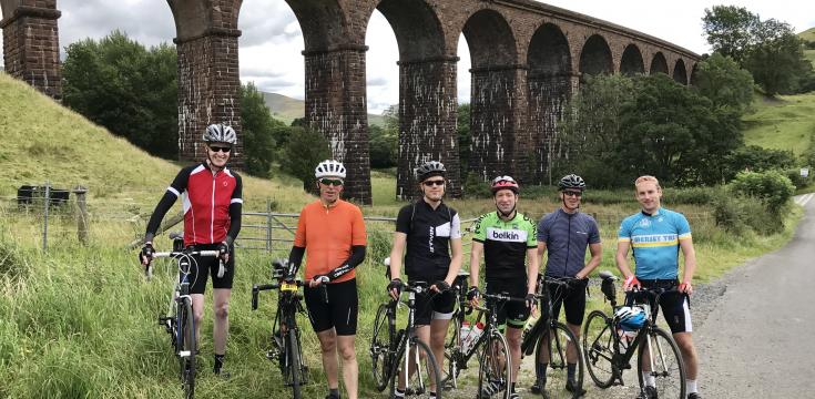 Group shot in front of viaduct
