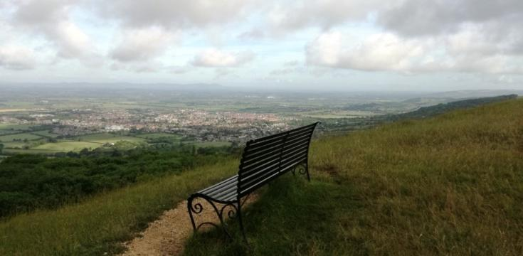 Bench on Cleeve Common with view over countryside