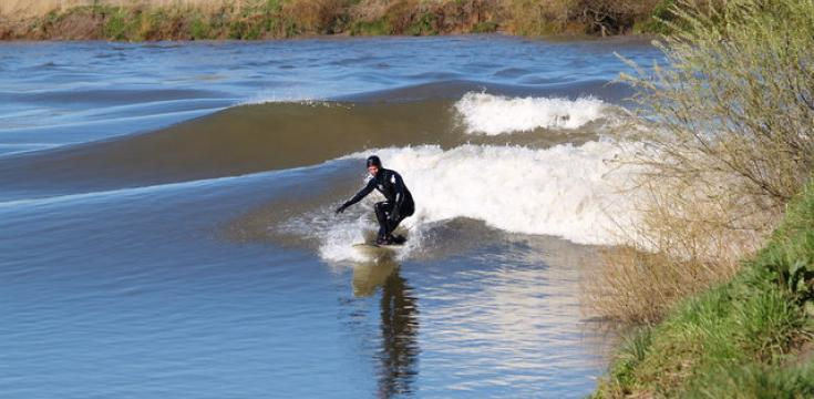 Surfer riding the Severn Bore