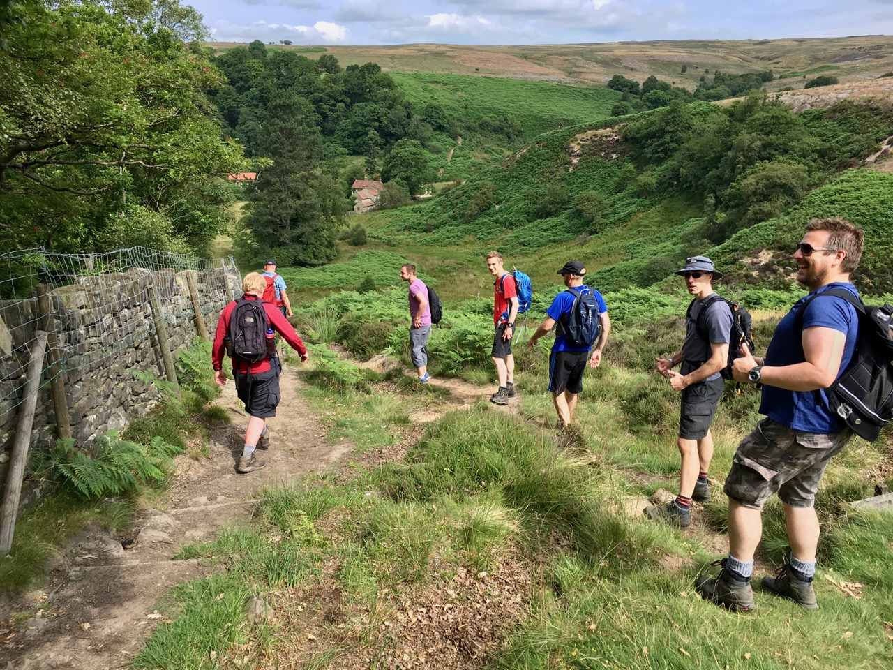 An OutdoorLads group hiking across moorland